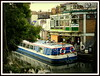 Houseboat passing through Camden Lock, London, 2014