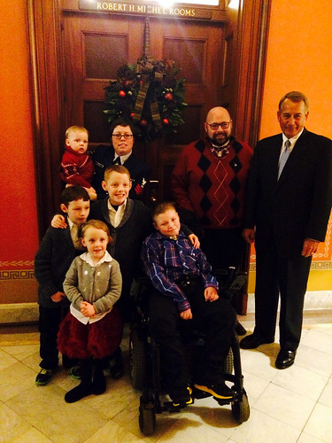 Aaron Urban, front, poses with his four siblings, his parents, Jeremy and Leisha, and Speaker of the House John Boehner before the ceremony to light the 2014 U.S. Capitol Christmas Tree. Aaron, who is battling brain cancer, was given the honor after efforts by Make-A-Wish Mid-Atlantic, who also is helping to fulfill his wish of spending the holidays in New York City. (Photo courtesy Make-A-Wish Mid-Atlantic)