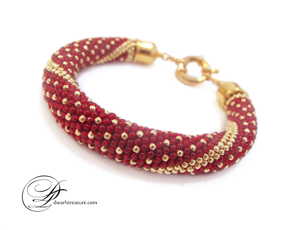 elegant ruby red and gold polka dot beaded crochet bracelet