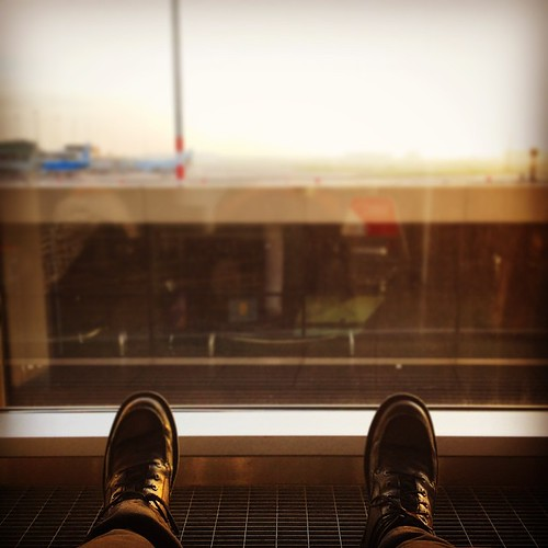 , Getting my feet up. The transfer lounge at Schiphol has these nice reclined seats which are just made for catching a crafty nap. At this rate I might even feel human again! #amsterdam #schiphol #airport #ams #seat #recliner #feet #boots #window #aeroplane, My Travels Blog 2020, My Travels Blog 2020