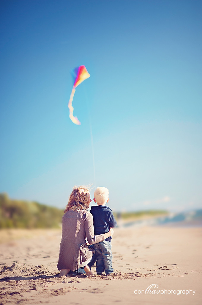 mother and son with kite on beach family photography