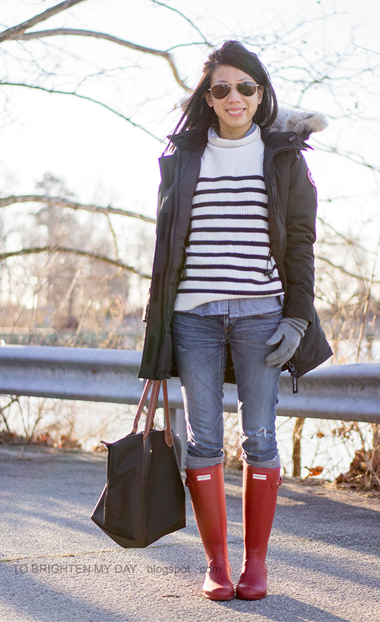 black parka, striped sweater, chambray shirt, gray gloves, red rain boots