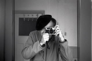 reflected self-portrait with Mamiya 135 EE camera and black beret