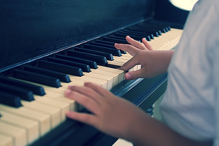 Playing piano with small hands..