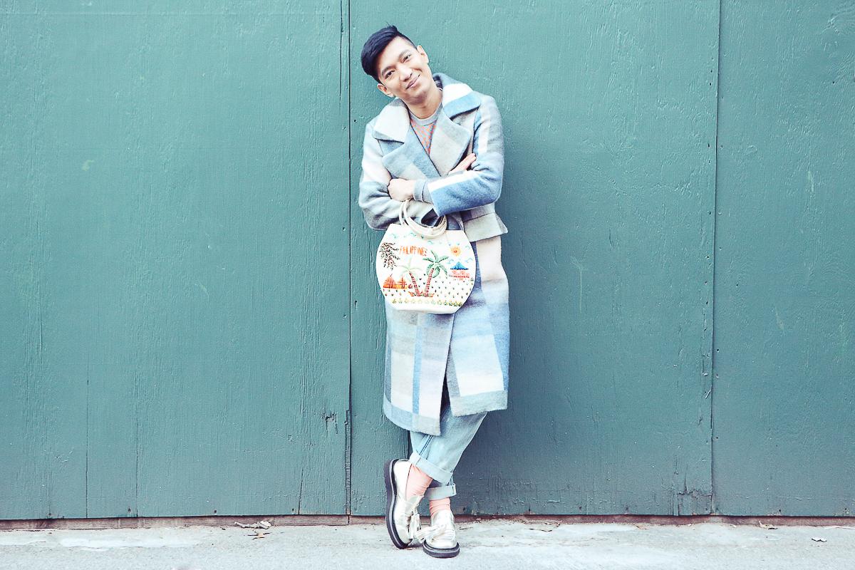 Bryanboy holding a Philippines bag in Williamsburg, Brooklyn