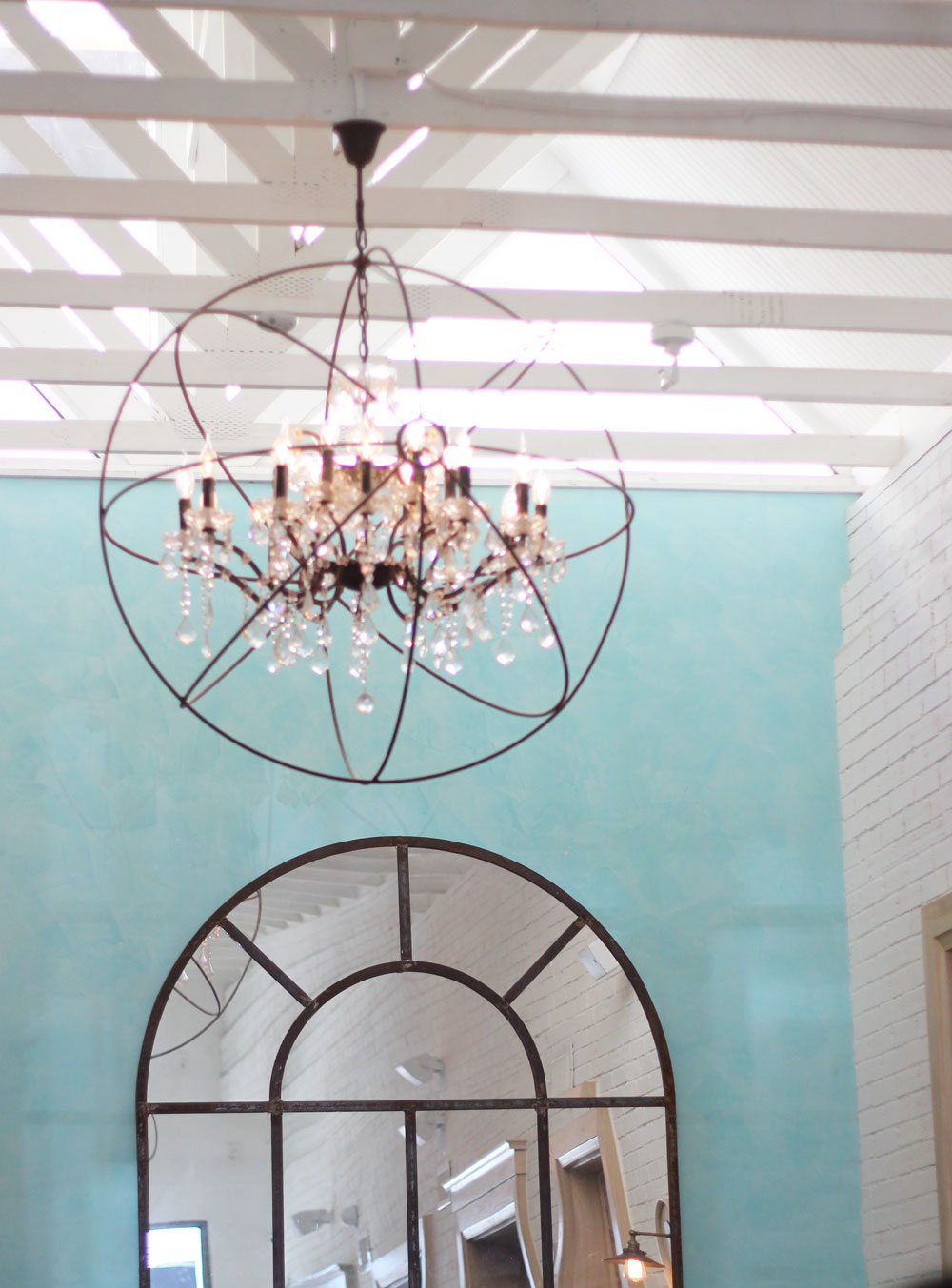 Rustic ball orbit chandelier