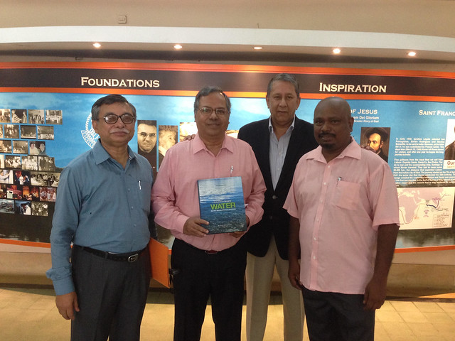 Ranjit Barthakur presenting the water book to Fr. E Abraham, director XLRI on 5th July at the institute in Jamshedpur.  Also present Fr George S, Dean Administration and Dr Pranabesh Ray, Dean Academics.