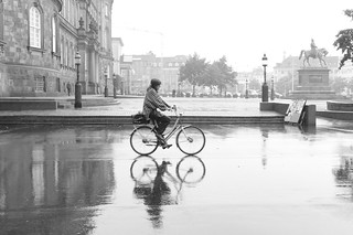 Image of Frederik VII. leica people woman wet bicycle reflections denmark christiansborg wetreflection bicyclerider aposummicronm aposummicronm50mmasph 50mmf20asph