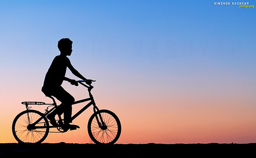 street sunset india motion color colors bicycle movement twilight shadows ride dusk story cycle backlit drama assam silhoutte tranquil ind guw