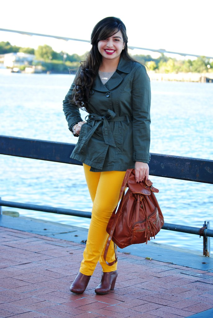 olive green short trench coat | mustard pants | brown backpack