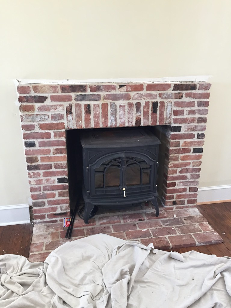 a custom diy fireplace mantel beneath our shiplap old town home