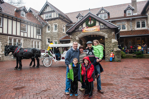 Christmas at Cabrini - alumni with a horse-drawn carriage at the mansion