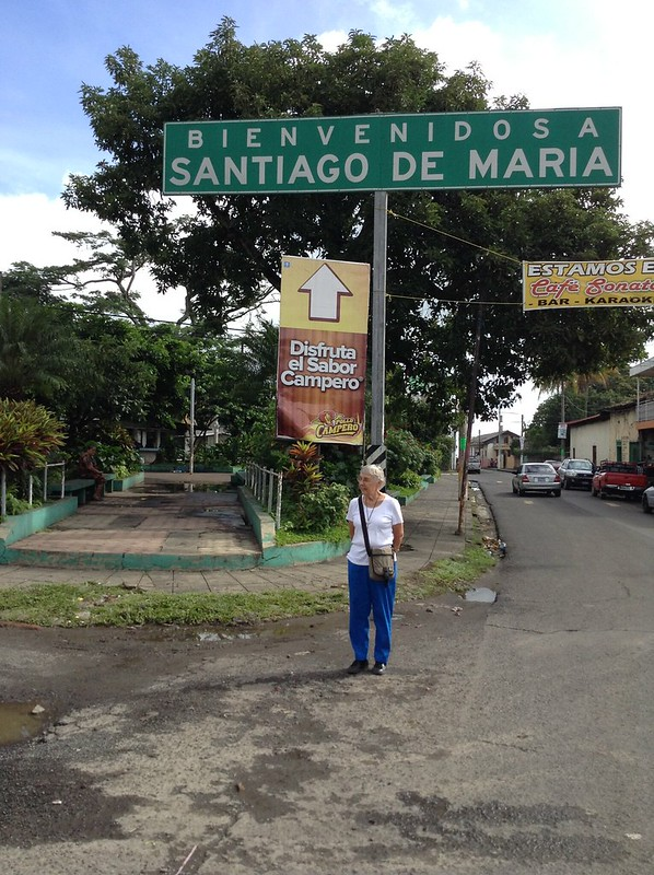 Sister Marilyn Charette standing under the entrance sign to the city of Santiago de Maria, the seat of our Diocese  of Santiago de Maria.