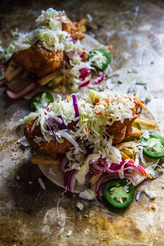 Kitchen Sink Tacos, with avocado, jalapeño, pickled onions, french fries, fried shrimp and slaw!