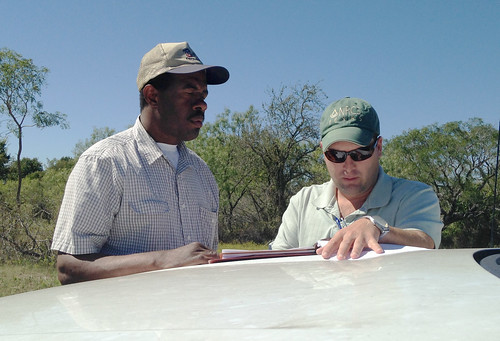 Rickie Roddy (left) of McLennan County Texas has worked closely with the Natural Resources Conservation Service on a conservation plan on conservation practices ranging from pasture planting to establishing water sources for his cattle herd. NRCS photo by Clete Vanderburg.