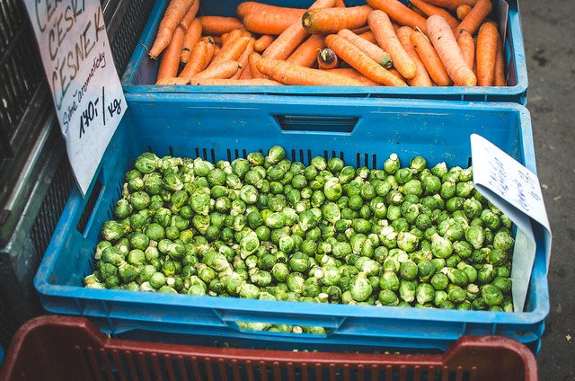 Brussels Sprouts and carrots for sale at Prague's Vinohrady Farmer's Market.