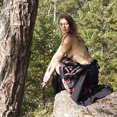 Siren. Model @mslulee with an arbutus on her back.