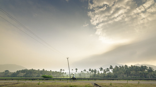 life sky people sunlight india man beautiful sunshine skyline clouds sunrise landscape dawn nikon village south wideshot country wide streetlife bluesky tokina cycle incredible tamil tamilnadu indi roi routine melur 1116mm rootsofindia lingeswaran nikond7000 121clicks malishots