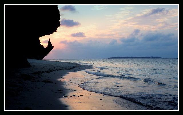 SUNSET AT SESOKO BEACH, MINA ISLAND IN THE DISTANCE