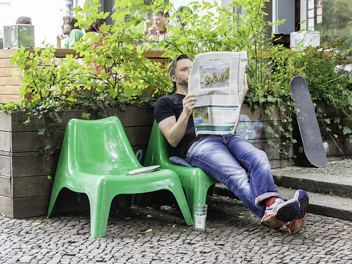 Man, reading Newspaper
