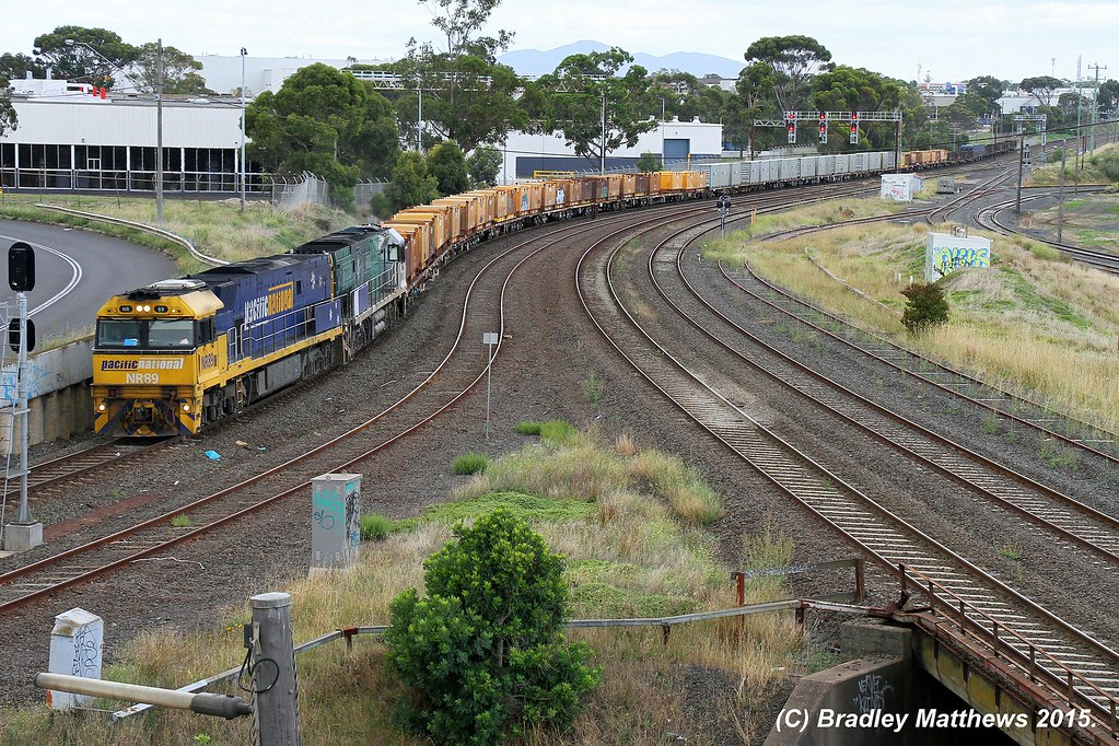 NR89-NR85 (SS) with late running 5MP2 down Steel goods to Perth at Nth Geelong (15/1/2015) by Bradley Matthews