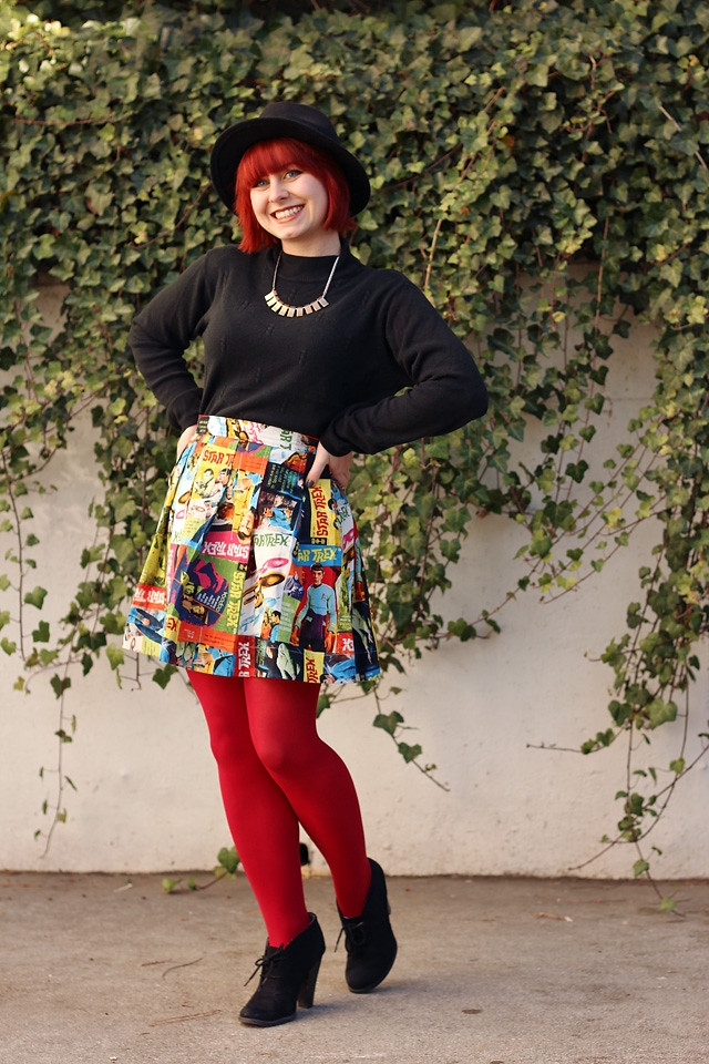 Pleated Star Trek Skirt, Red Tights, Black Mock Neck Sweater, and Black Ankle Boots