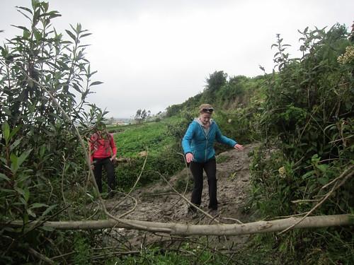 Carefully hiking the mud path in Karjia