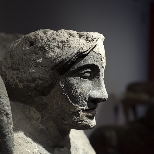 Statue of a female sphinx in grey tuff, from Pompeii (1)