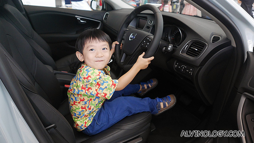 Asher gets to pretend drive a Volvo car