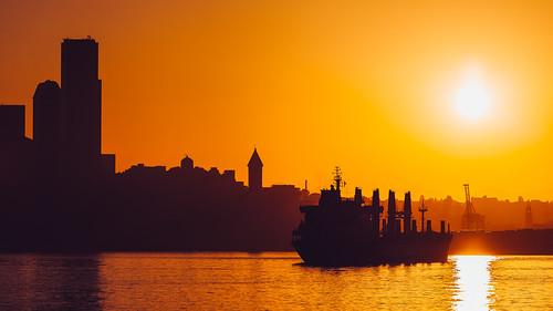 seattle morning orange sun water yellow sunrise washington cityscape pacificnorthwest pugetsound elliotbay bloat canonef100400mmf4556lisusm canoneos5dmarkiii johnwestrock