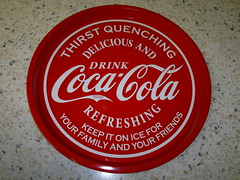 soft drink(0.0), plant(0.0), carbonated soft drinks(0.0), food(0.0), drink(0.0), cola(0.0), coca-cola(0.0), red(1.0), label(1.0), brand(1.0),