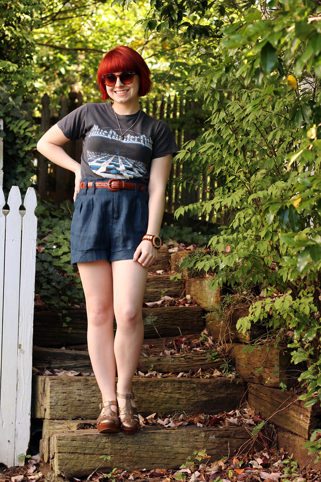 Vintage Blue Oyster Cult T-shirt, Navy Blue Shorts, Wood Watch, and Bronze Shoes