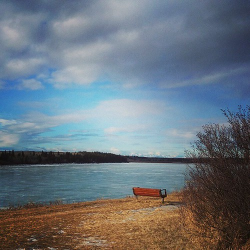 frozen water, a bench and some sky ... #yyc #glenmore #winter #walking #bench #solitude #sky #clouds #chinook #calgary #capturecalgary