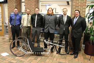 GM-Achilles Freedom Hand Cycle Frame Optimization Team with poster