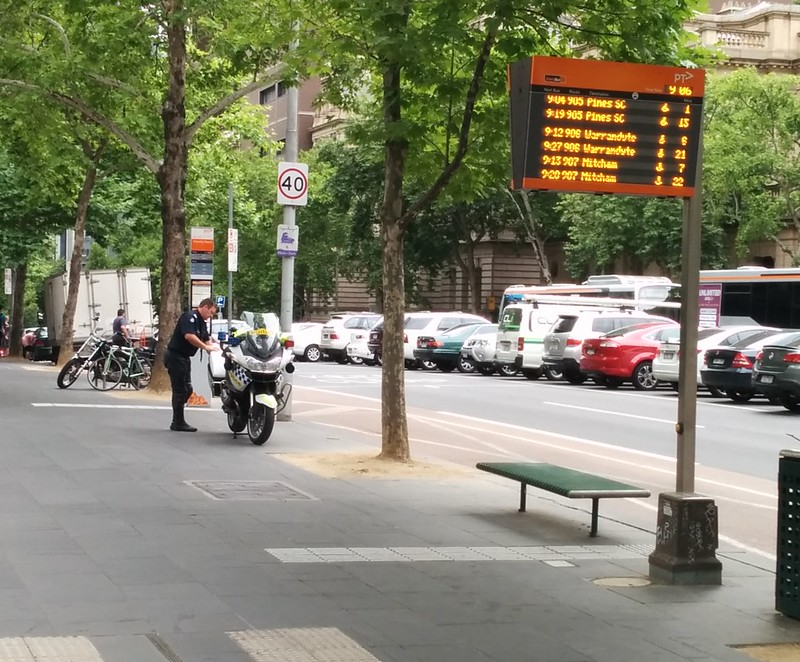 Perhaps even police are unaware the guidelines say you shouldn't park motorcycles in bus stops