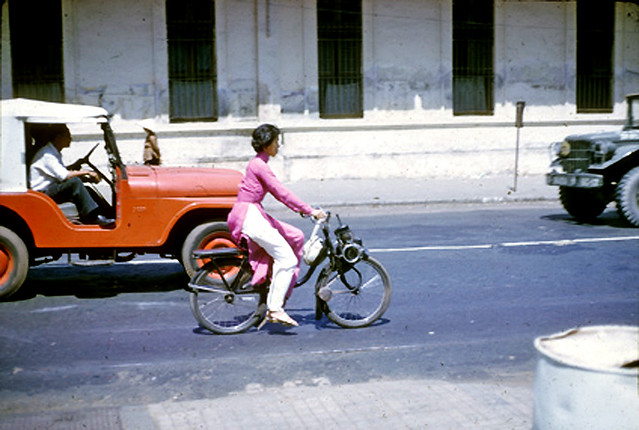 SAIGON 1965 - Lady riding Vélo Solex