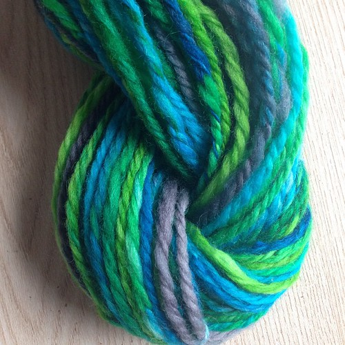 """City Park"" on Polwarth, by a thing for string fiberworks. 2oz, 104yds worsted chain-ply, for kid socks. Still spinning the other half of the fiber while igo ahead and cast on this half. #handspun #spinningyarn #yarn"