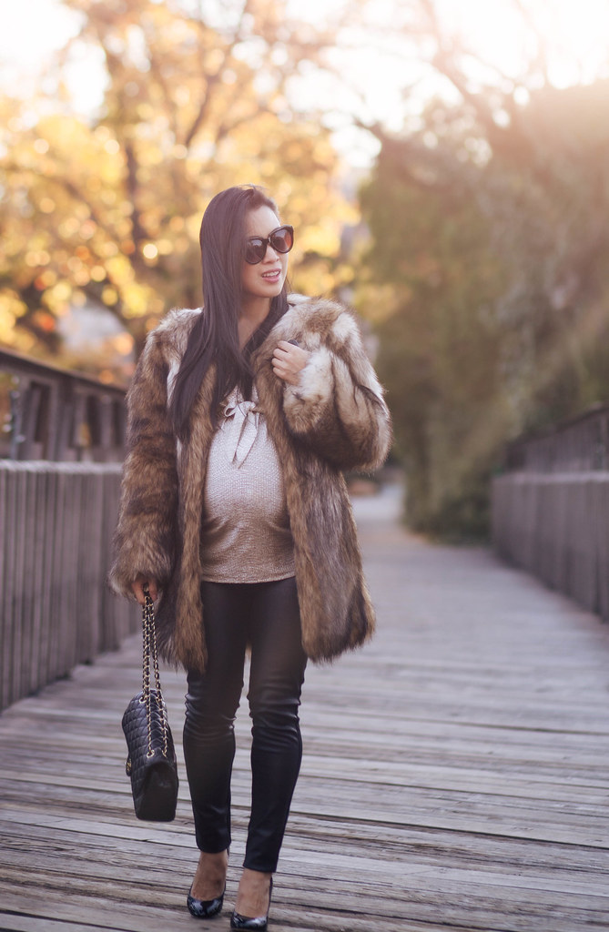 cute & little blog | petite fashion maternity pregnant | chicwish faux fur coat, gold foil bow top, leather ponte pants, chanel flap purse | winter outfit