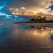 last light on Bamburgh by pixellesley