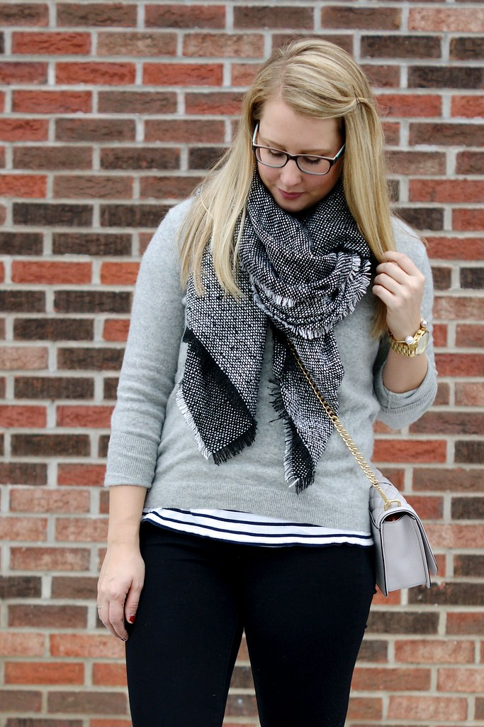 grey sweater over striped tee