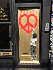 Unify in the style of Banksy