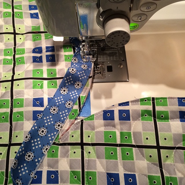Coming up on a pivot. I love bias binding. #pickledish #denyseschmidt #quilt