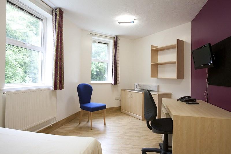 A bedroom in Polden Court
