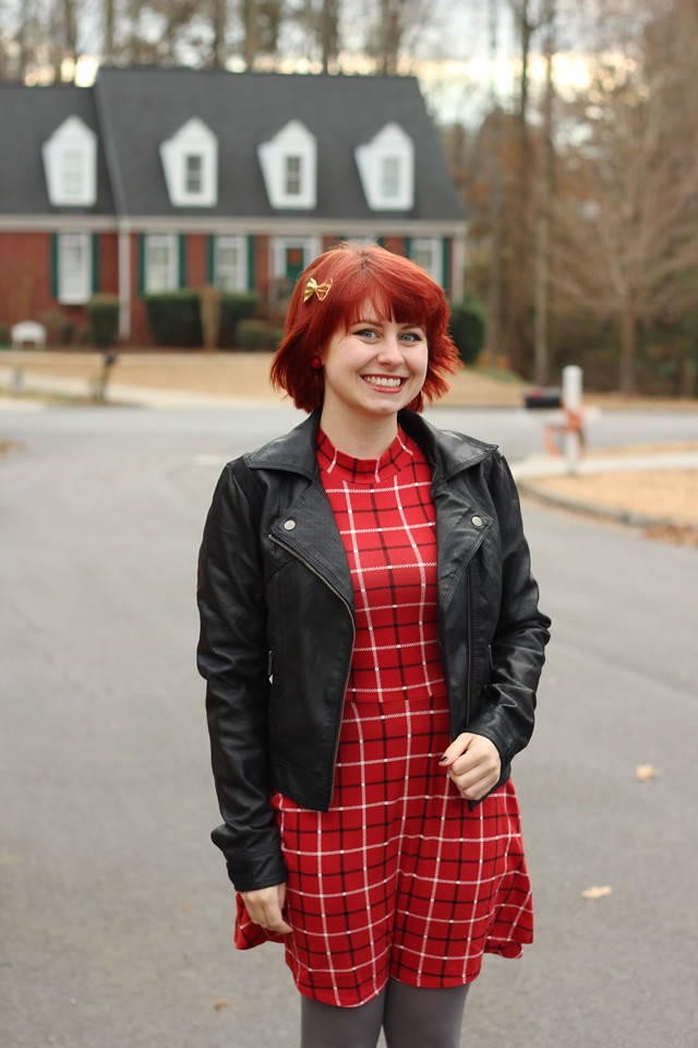 Red Hair, Red Turtleneck Dress, and a Black Leather Jacket