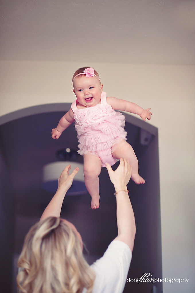 Hudsonville, Michigan baby photographer - baby girl in the air