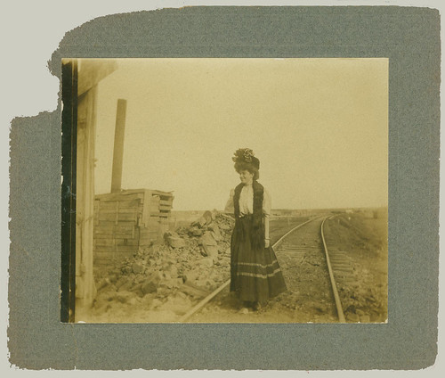 Woman on the railway, with hat.