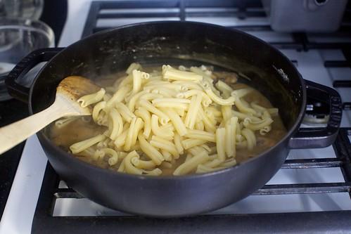 add pasta to saucy mushrooms