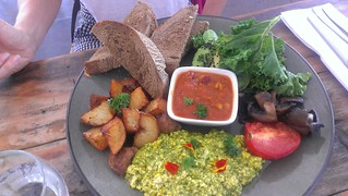 Hearty Start with Tofu Scramble, Spinach, Avocado, Tomato, Housemade Beans, Home Fries at Greenhouse Factory