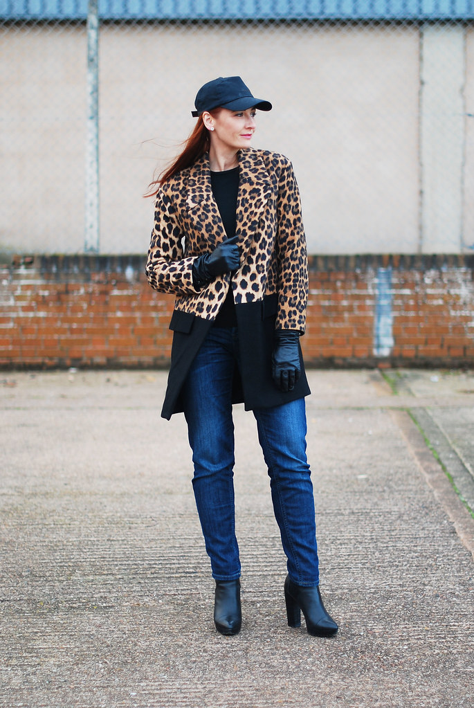Leopard print coat with baseball cap and jeans