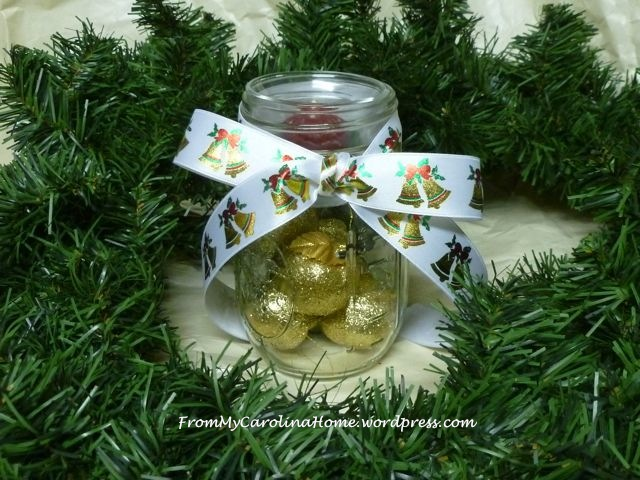 Mason jar with votive, gold apples, bow
